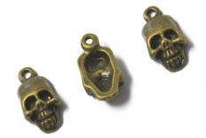 20pcs Antique Bronze Alloy Skull Pendent Jewelry Making Charms (Intl)