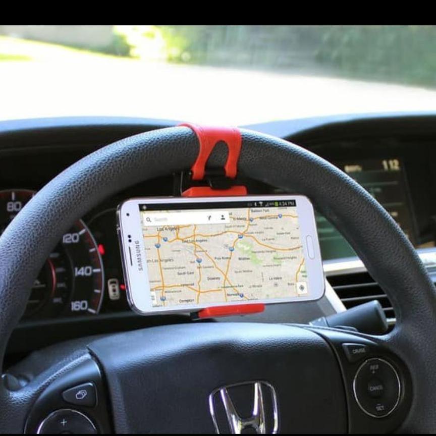 Holder setir mobil Car Steering Wheel Phone Socket Holder stir hp handphone GS  UNIVERSAL BISA SEMUA MEREK HP - Dipasang pada stir mobil - Klip berpelindung silikon sehingga tidak merusak hp/gps anda - Pemasangan mudah, tidak perlu alat tambahan - Lebar