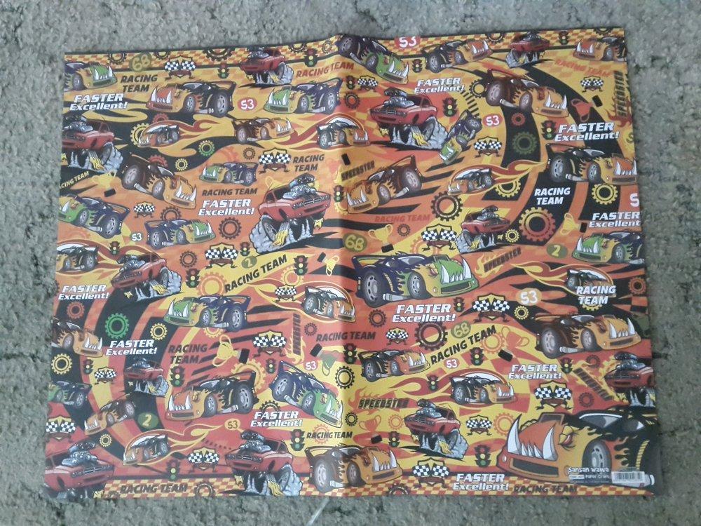 Kertas Kado Kids warna dasar oranye motif mobil sekaligus jasa pembungkusan # Favorit Toys favorit_toys