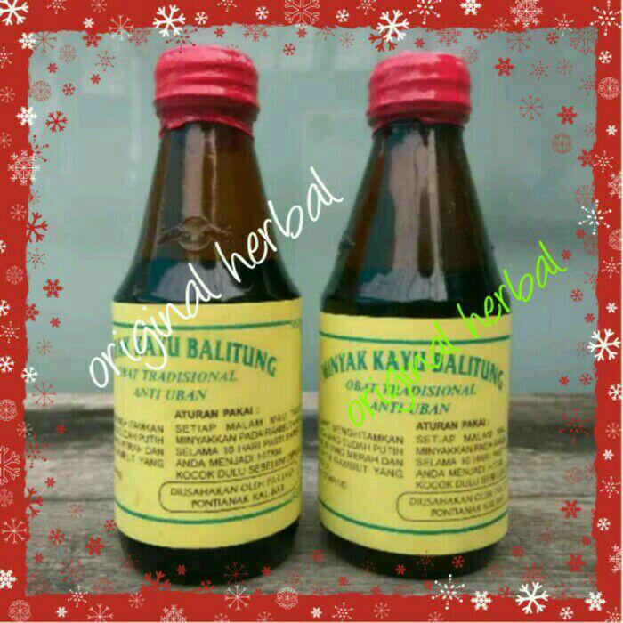 2 botol Minyak kayu balitung Kalimantan/penghilang uban