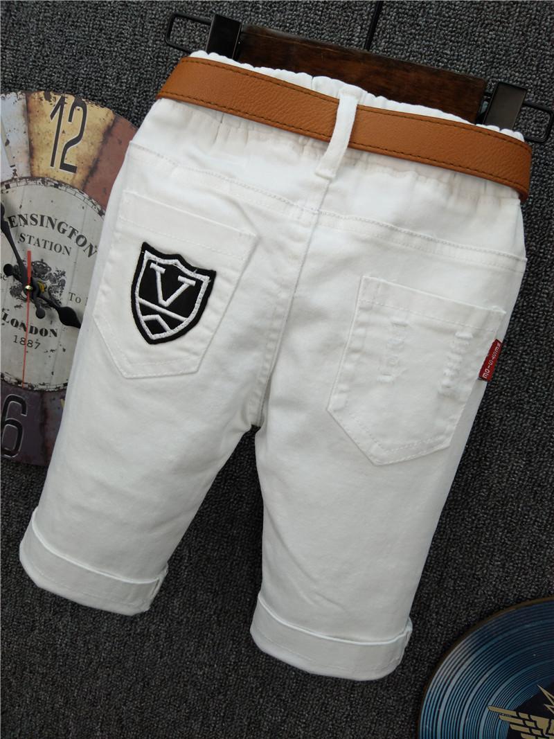 Anak laki-laki musim panas model baru Gaya Korea putih Sepertujuh celana jeans Petpet All-match Modis membentuk tubuh berlubang celana pendek Anak Balita dan Diatas Balita