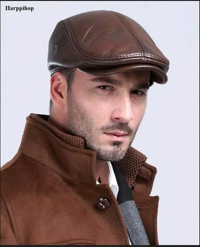 Topi pet kulit masa kini