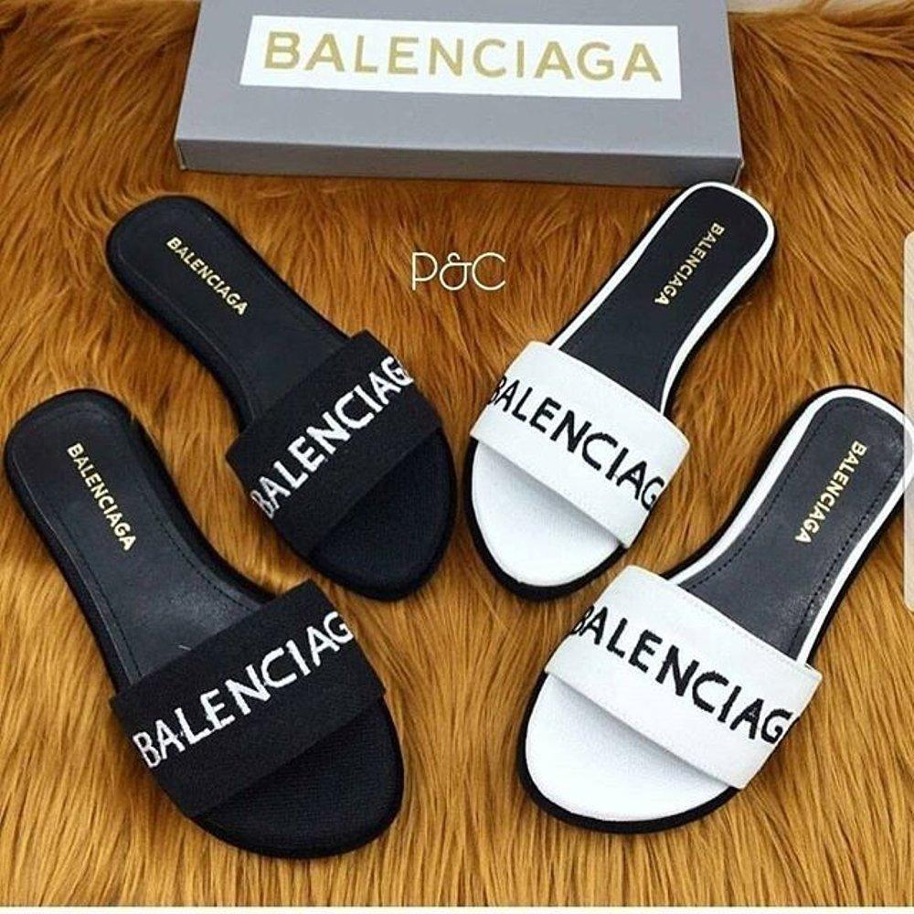 Lazada. Ke Toko. Sneakers Wanita HOT PROMO Ready Sandal Flat BLC bahan  Semikulit Warna HITAM dan PUTIH Termurah Di b770994c69