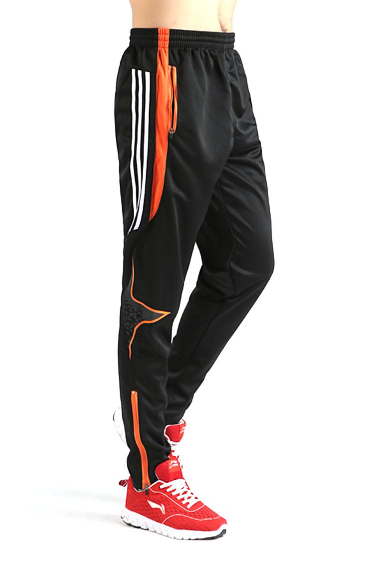 Olahraga sepak bola pria lari keringat celana panjang celana bajuolahraga cepat kering jeruk .