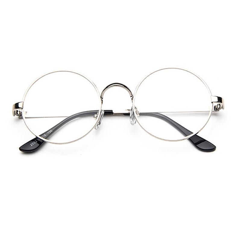... Kacamata bergaya retro dengan frame berbahan logam bulat warna perak dengan lensa mata